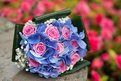 Wedding bouquet with hydrangea and pink roses. Outdoor Royalty Free Stock Photography