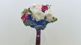 A wedding bouquet of hydrangea, pion-shaped rose, carnation and eucalyptus greens. Bouquet in rotation. A wedding bouquet of hydrangea, pion-shaped rose stock video