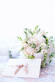 Wedding bouquet with invitation card Stock Photography