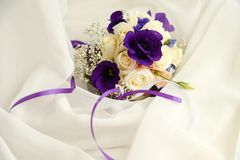 Wedding bouquet and wedding invitation on white background with copy space stock images