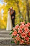 Wedding bouquet. And just married couple on the background Stock Image