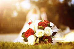 Wedding bouquet laying on the grass Stock Photos