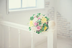 Wedding bouquet lie on a railings Stock Images