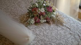 Wedding bouquet lies on bed.  stock video footage