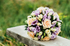 Wedding bouquet lies on the bench.  Royalty Free Stock Image
