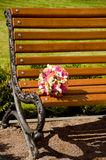Wedding bouquet lies on the bench.  Royalty Free Stock Photos
