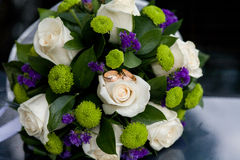 Wedding bouquet lies on the car. Wedding day. Stock Image