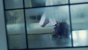Wedding bouquet lies on the floor. In the room stock footage