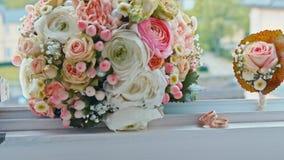 Wedding bouquet lies on the window.  stock video