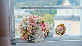 Wedding bouquet lies on the window.  stock footage