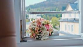 Wedding bouquet lies on the window.  stock video footage