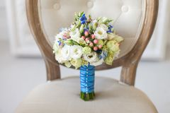 Wedding bouquet on a light brown vintage chair stock images