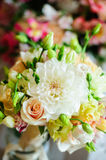 Wedding bouquet with light-colored summer flowers Stock Photos