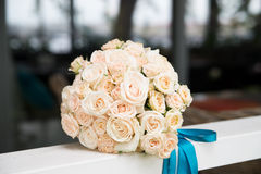 Wedding bouquet with light orange roses. Outdoor Royalty Free Stock Photo