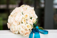 Wedding bouquet with light orange roses. Outdoor Stock Photography
