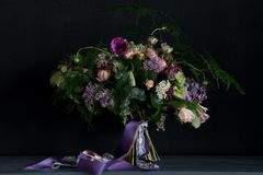 Wedding bouquet with lilac. Cute wedding bouquet with lilac and other spring flowers made by florist Royalty Free Stock Image