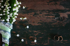 Wedding bouquet of lilies of the valley and rings Stock Photo
