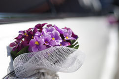 Wedding bouquet on limousine door handle. Bokeh Stock Photos