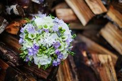 Wedding bouquet. On logs birch royalty free stock image