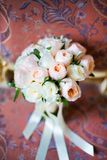 Wedding bouquet lying on chair Royalty Free Stock Photos