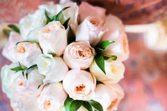 Wedding bouquet lying on chair Stock Images