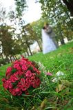 Wedding bouquet lying on a green grass Stock Images
