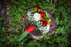 Wedding bouquet lying on green grass Stock Photo