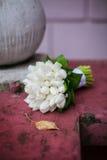 Wedding bouquet. Lying on a rock stock photos
