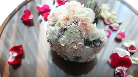 Wedding bouquet lying on the table stock video footage