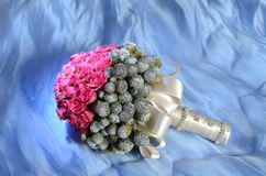 Wedding bouquet against blue background Royalty Free Stock Images