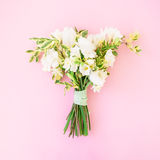 Wedding bouquet made of white flowers on pink background. Flat lay, top view. Wedding background. Wedding background. Wedding bouquet made of white flowers on Royalty Free Stock Image