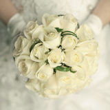 Wedding bouquet. Made of white roses at bride's hands. studio shot stock photography