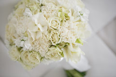 Wedding bouquet made of white roses on a white background.  Stock Photos
