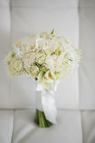 Wedding bouquet made of white roses on a white background.  Royalty Free Stock Photography