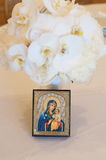 Wedding Bouquet with Madonna and Child. Wedding Bouquet made with orchids and a religious image of a Madonna and Child Royalty Free Stock Image