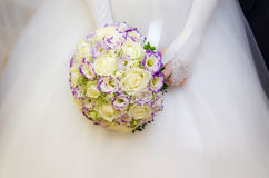 Wedding bouquet with many white roses in hands Stock Images