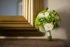 Wedding bouquet and mirror Royalty Free Stock Images