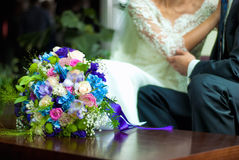 Wedding bouquet near bride and groom Royalty Free Stock Images