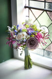 Wedding bouquet near a window Stock Photography