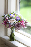 Wedding bouquet near a window Stock Images