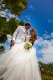 Wedding bouquet and newlyweds Stock Image
