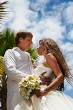 Wedding bouquet and newlyweds Stock Images