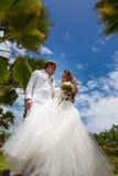 Wedding bouquet and newlyweds Royalty Free Stock Image