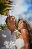 Wedding bouquet and newlyweds Stock Photo