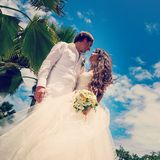 Wedding bouquet and newlyweds Royalty Free Stock Photo