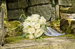Wedding bouquet on an old chair Stock Images