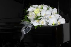 Wedding Bouquet On Black Piano Stock Photography