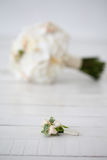 Wedding bouquet of orchids and boutonniere on white background.  Stock Photos