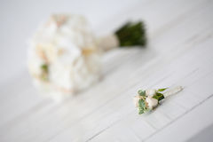 Wedding bouquet of orchids and boutonniere on white background.  Stock Photo