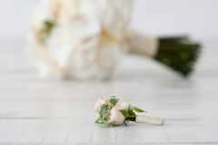 Wedding bouquet of orchids and boutonniere on white background.  Stock Photography